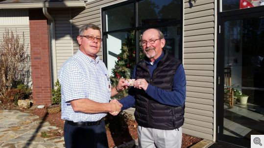 Ed Doyle presents a gift card to Ron Maguire of Alternative Learning Experience